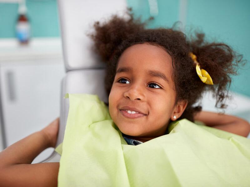 Pediatric Dentistry Patient In Dental Chair
