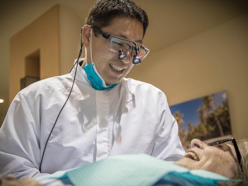Dentist Eddie Kuo With Senior Patient